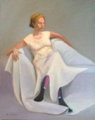 Woman seated on chaise, dressed in white, with colorful stockings