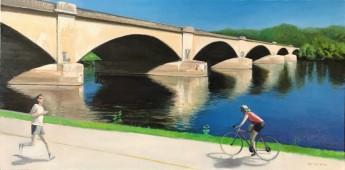 Runner and biker on trail near Columbia Bridge over Schuylkill River