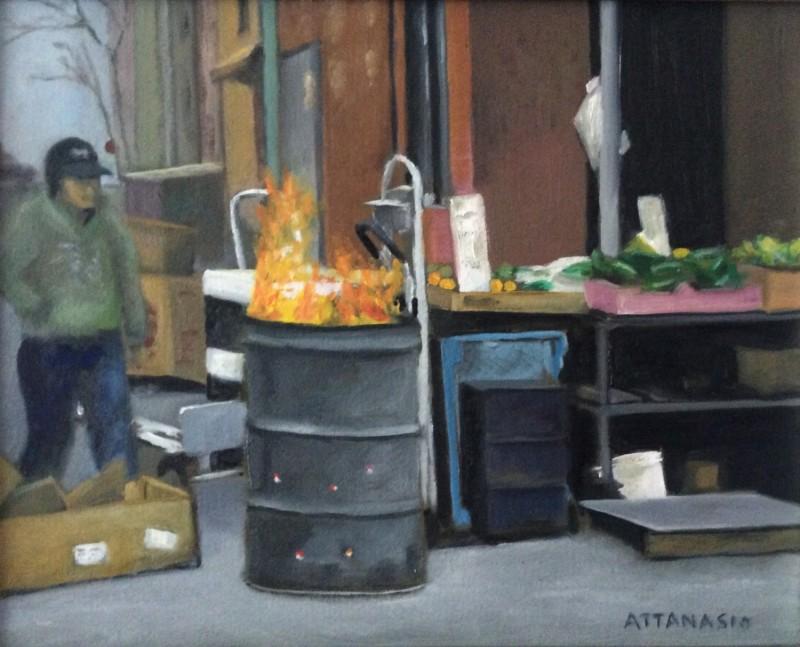 Man at fire barrel in Italian Market, South Philadelphia