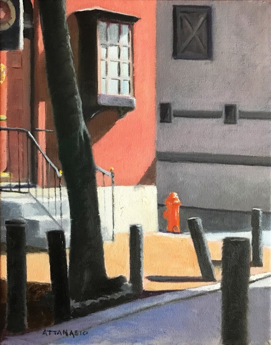 Corner building on tiny street in bright sunlight